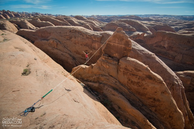 Andy Lewis getting lost in the infinite fin features of Moab on a highline he established last year, Weigh Wyrd (205' long).