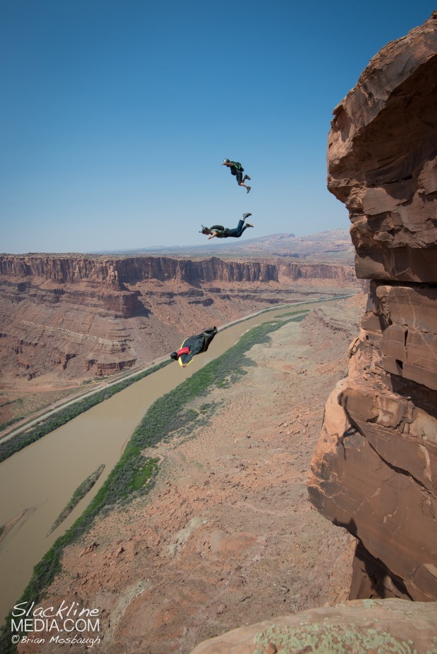BASE jumpers Andy Lewis and Jimmy Peterson making a leap into the depths below as Graham Hunt leads the way while opening a new wingsuit exit in Moab.