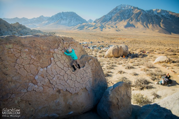Aleta Edinger dances delicately up the fine patina granite of the Buttermilks bouldering area in Bishop, CA.