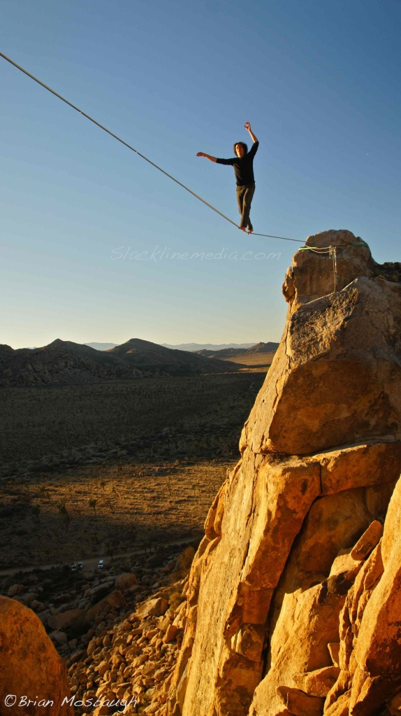 Amongst the stunning landscape of Joshua Tree National Park, Ethan Holt, welcomes the new year with a sunset free-so-loco crossing of