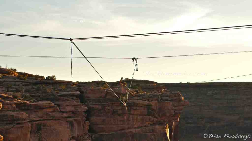 """Jared Alden tests his balance on the newly constructed  """"Floatline,"""" consisting of 5 slacklines meeting in space to create this 130' long beast. The floatline was tensioned by hand, without the aid of pulleys, making for a very loose and disorienting line to attempt. It still remains unwalked..."""