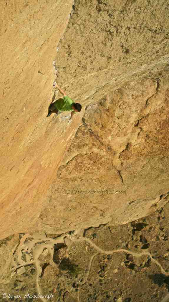 Expanding this week's Photo of the Week vocabulary into the world of free-solo climbing, I bring you one of my favorite shots which was taken hanging 100' from the top of Morning Glory Wall at Smith Rock State Park. Back in the summer of 2012, on sweltering 90 degree day, Scott Bennett and Brad Gobright decided to test their wits with an on-sight ascent, no ropes necessary, climb of the classic Zebra Zion route. These two elite climbers aren't new to the world of ropeless climbing and were doing so well below their physical limit and previous experience of climbing big walls. Much respect and appreciation for their boldness and talent!