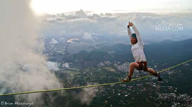Scott Rogers practicing yoga 2,700 feet above Rio de Janeiro on the Classic Gavea Stone highline (established by Hugo Van Erven in 2006).