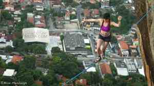 Hayley Ashburn tunes out the buzz of the city below to finish her belt loop swami walk
